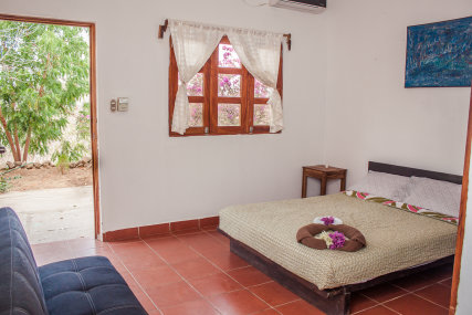 Playgrounds is a comfortable room with a double bed and futon/couch This room is excellent for a couple, a couple with a child or even several friends traveling together. When folded out as a bed, the futon is slightly shorter in length than a standard tw