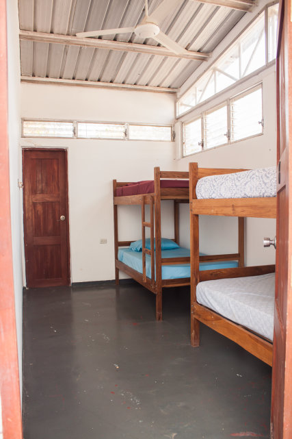 Popoyo can be a private room or a shared dorm room with a ceiling fan and private bath. There are four twin beds in two bunkbed sets. It can be rented on a walk-in basis for $12/bunk. Reservations for the entire room always take precedence over walk-ins.