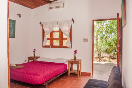 Pangas is a comfortable room with a queen bed and futon/couch This room is excellent for a couple, a couple with a child or even several friends traveling together. When folded out as a bed, the futon is slightly shorter in length than a standard twin bed