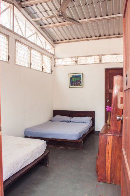 Rosada is a standard room with a ceiling fan and private bath.