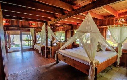 Two-story hardwood beachfront luxury Uma