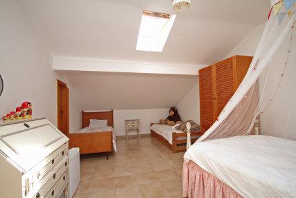 Attic room three single beds