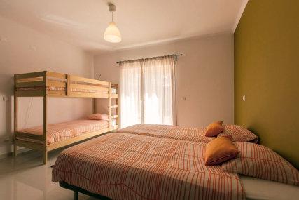 Deluxe Suite - 2 single beds, 1 bunk bed