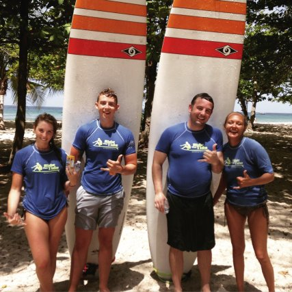Happy surfers learn to surf at Ride The Tide Surf School