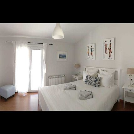 1st floor room with double bed, bathroom and small balcony facing the north with views of the garden; at the backside of the house.
