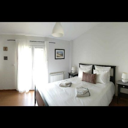 1st floor room with double bed, bathroom and small balcony facing the south; at the frontside of the house.